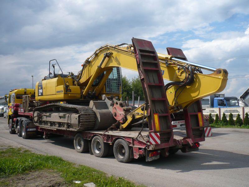 Transport spesjalistyczny MAN 6x4 koparka.jpg